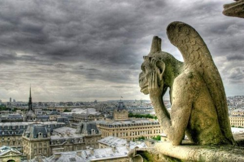 a-gargoyle-on-notre-dame-catherdral-in-paris1
