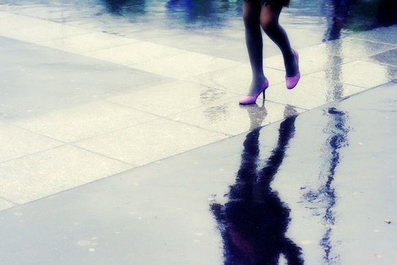 Chic Fashion in the Rain in Paris, means still wearing what you like, even if that means purple heels and a skirt.