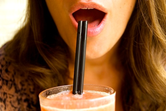 Flirting in France is in the art of seduction, which can be about how you drink your cocktail, like this girl who is about to drink through a straw.