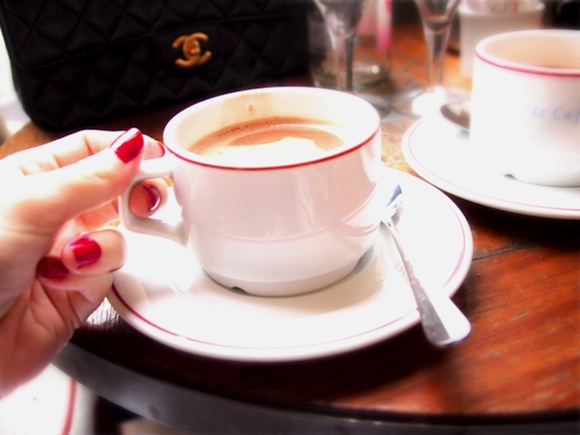 French beauty: French Women always have their nails done, like this woman holding a cup of hot chocolate at a bistro.