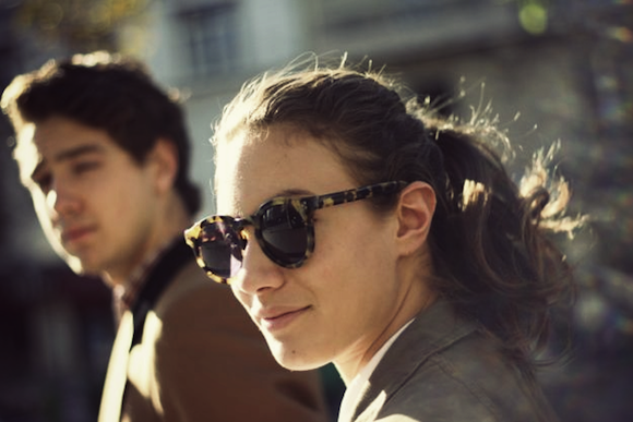 French beauty: French Women don't wear a lot of makeup, like this brunette woman who only wears chic sunglasses and no makeup.