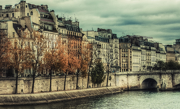 Becoming French, how to live and work in France, means you take leisurely strolls along the banks of the River Seine lined by Haussmannian apartment buildings.