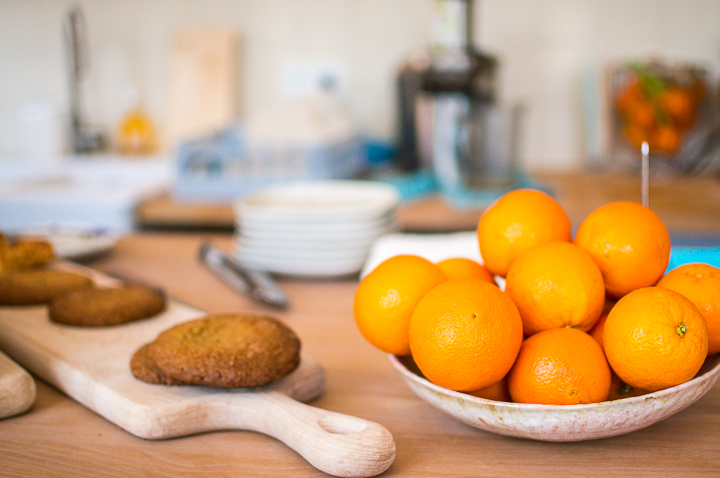 Freshly baked cookies next to a bowl of oranges on the counter of Paris fashion concept store The Broken Arm's coffee shop in the Marais.