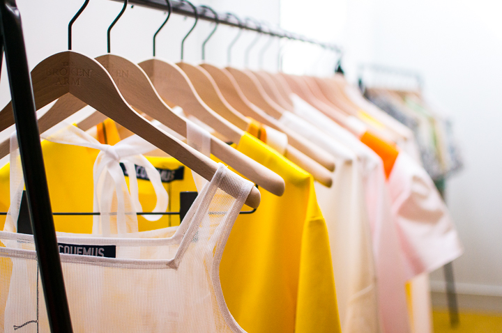 A rack of yellow and white cotton garments at Paris concept store The Broken Arm in the Marais.
