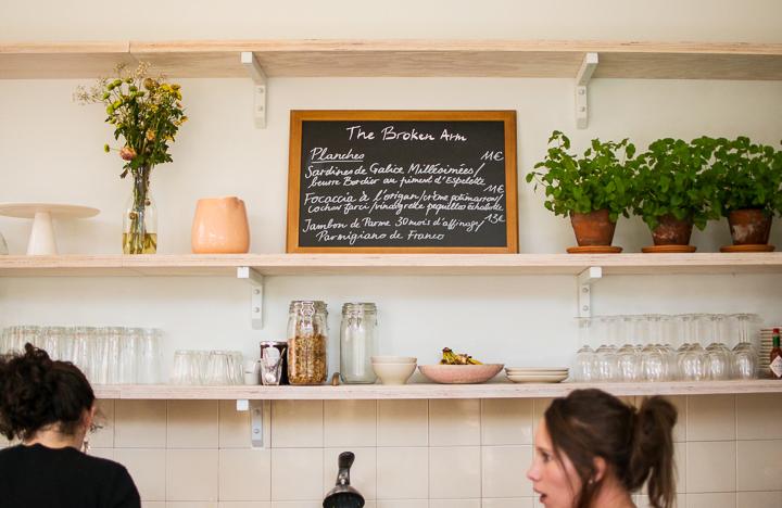 The Broken Arm Paris concept store's coffee shop with fresh flowers and a handwritten menu on a small blackboard.