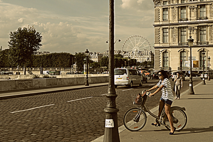 A Newly Single Girl in Paris riding her bike through the streets.