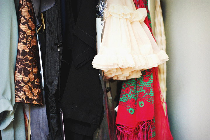 Shopping on a budget in Paris is possible when you know which vintage shops to go to where you can find all sorts of dresses like on this rack.