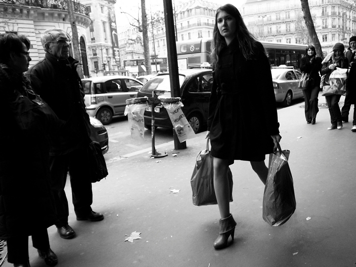 We love this woman's Parisian street style - her black miniskirt and high ankle boots.