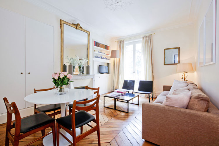 Decorating your Paris apartment is all about mixing period features with modern furniture.