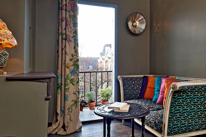 How you decorate your Paris apartment depends on the light and view like through this open balcony door looking out onto neighboring buildings.