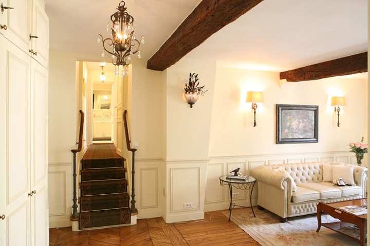 The most beautiful Paris apartments come with lots of original features like a beamed ceiling and parquet floors.