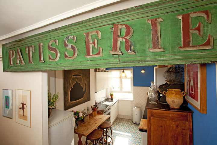 A vintage shop sign, like this one, which reads 'Patisserie', is a great way to add character to your kitchen if you want to decorate your home like a Parisian.