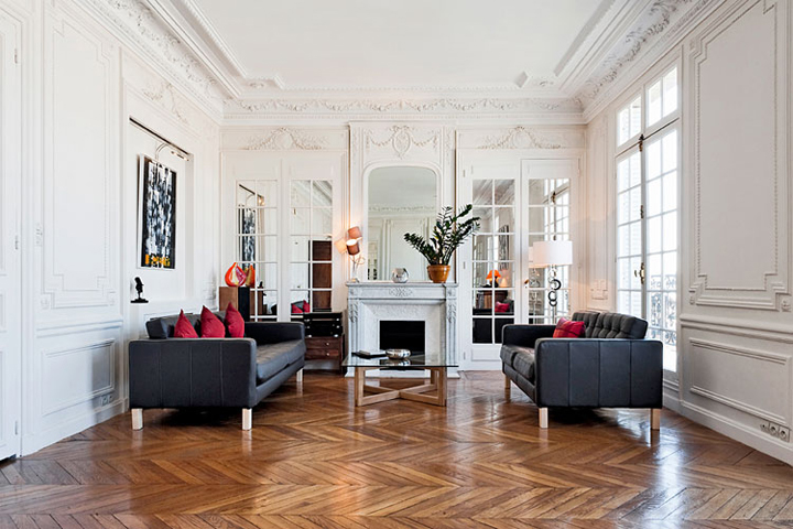 There are lots of ways of decorating your apartment like a Parisian, like mixing contemporary furniture to offset period features like a marble fireplace.