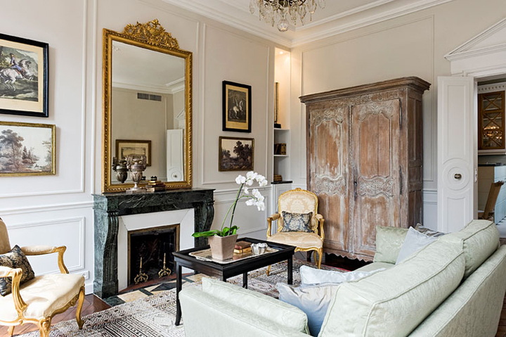 Paris apartments usually have parquet floors, marble mantelpieces and a gilded mirror.
