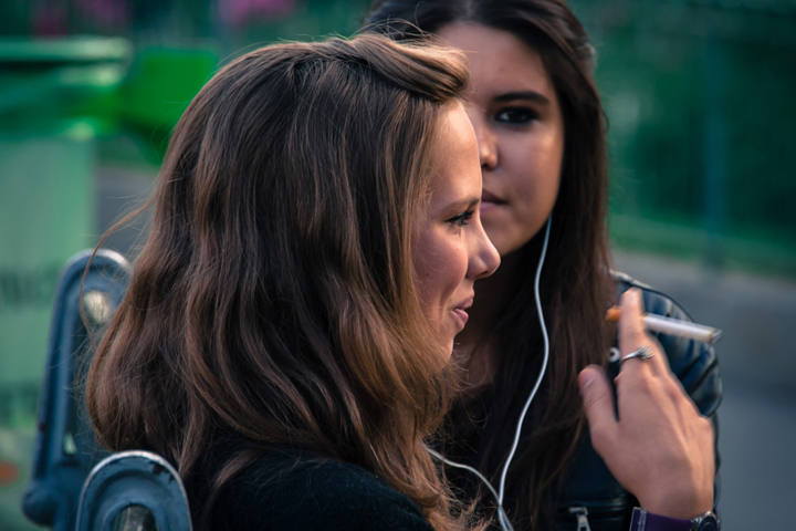 Parenting in Paris can be difficult, especially if they start smoking like these two girls sharing earphones.