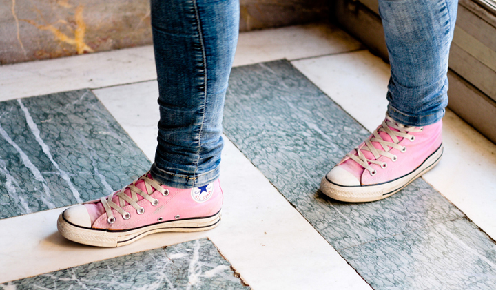 Parenting in Paris is about knowing what shoes to buy your teenagers, but Converse are always a good idea, like this girl wearing pink ones.