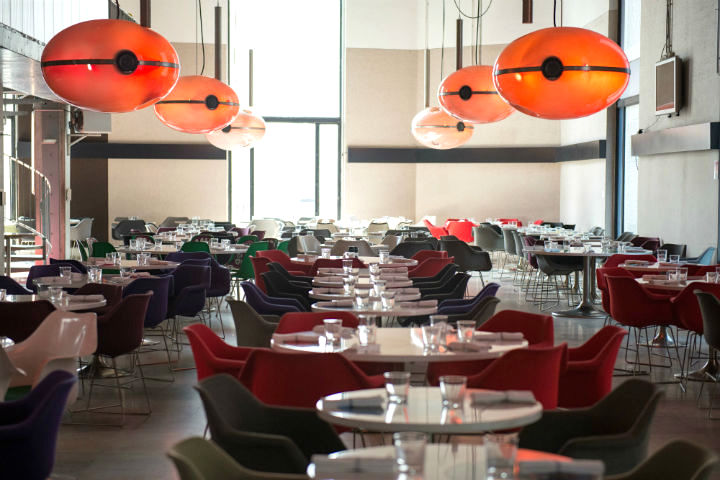Exploring the Hidden Gems of Paris' Chic 16th Arrondissement, including Tokyo Eat at the Palais de Tokyo Museum for Japanese style food in a 70s decor with orange bulbous lighting and low-slung colorful chairs.
