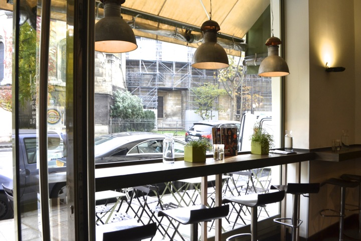 Window seating on high stools at affordable Italian restaurant Il Caffè in Paris' business district.