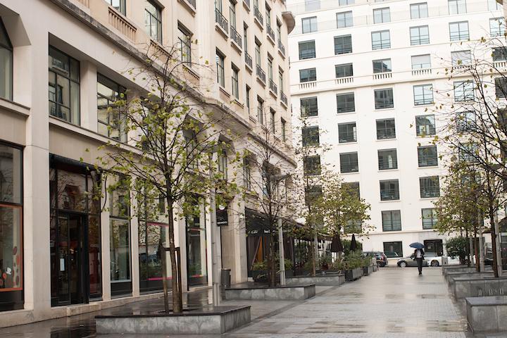 Elegant Eighth, Paris sidewalk lined with cafés.