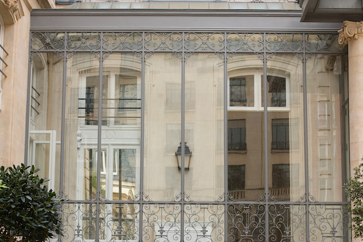 The ornate windows of an elegant home in Paris' 8th arrondissement.
