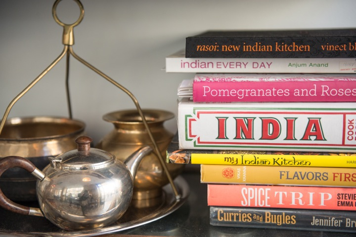 MG Road is one of the best restaurants in Paris for Indian food and has a shabby chic style with Indian artefacts like these brass pots and contemporary Indian recipe books.