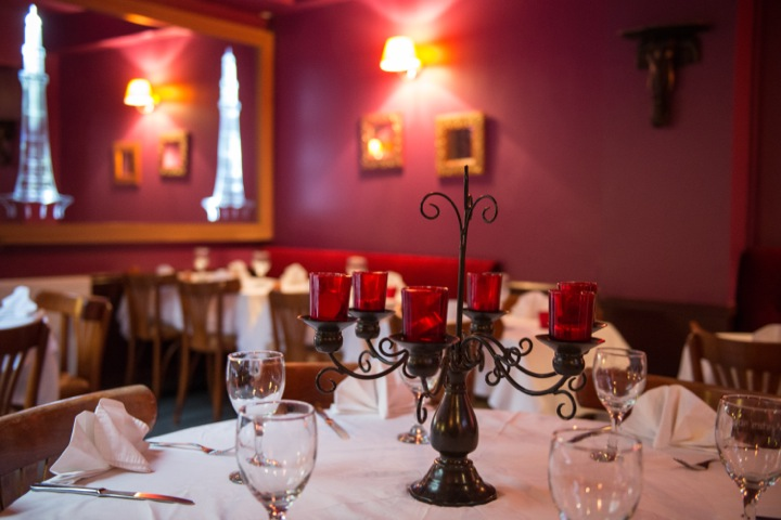 Inside top Paris Indian restaurant, the Jaipur Cafe, with its white table cloths and red walls.
