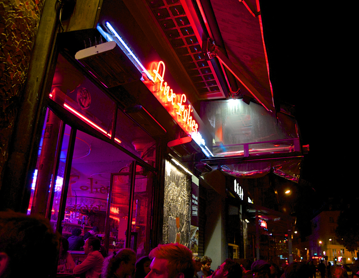 Paris 20th Arrondissement: Best bars, restaurants, and cafés around Belleville and Menilmontant, like Aux Folies, one of the area's best bars with its neon sign and buzzy atmosphere.