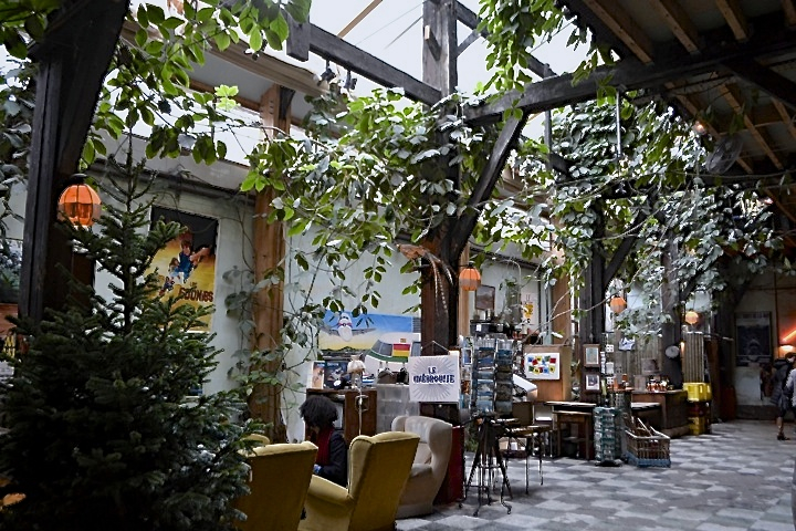 Inside bar and restaurant Le Comptoir General on Paris' Canal Saint Martin, which comes with lots of plants and vintage furniture.