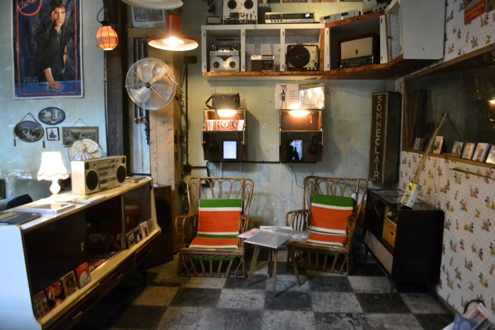 Inside bar and restaurant Le Comptoir General on the Canal Saint Martin in Paris, and its vintage decor of ghetto blasters and rattan chairs.