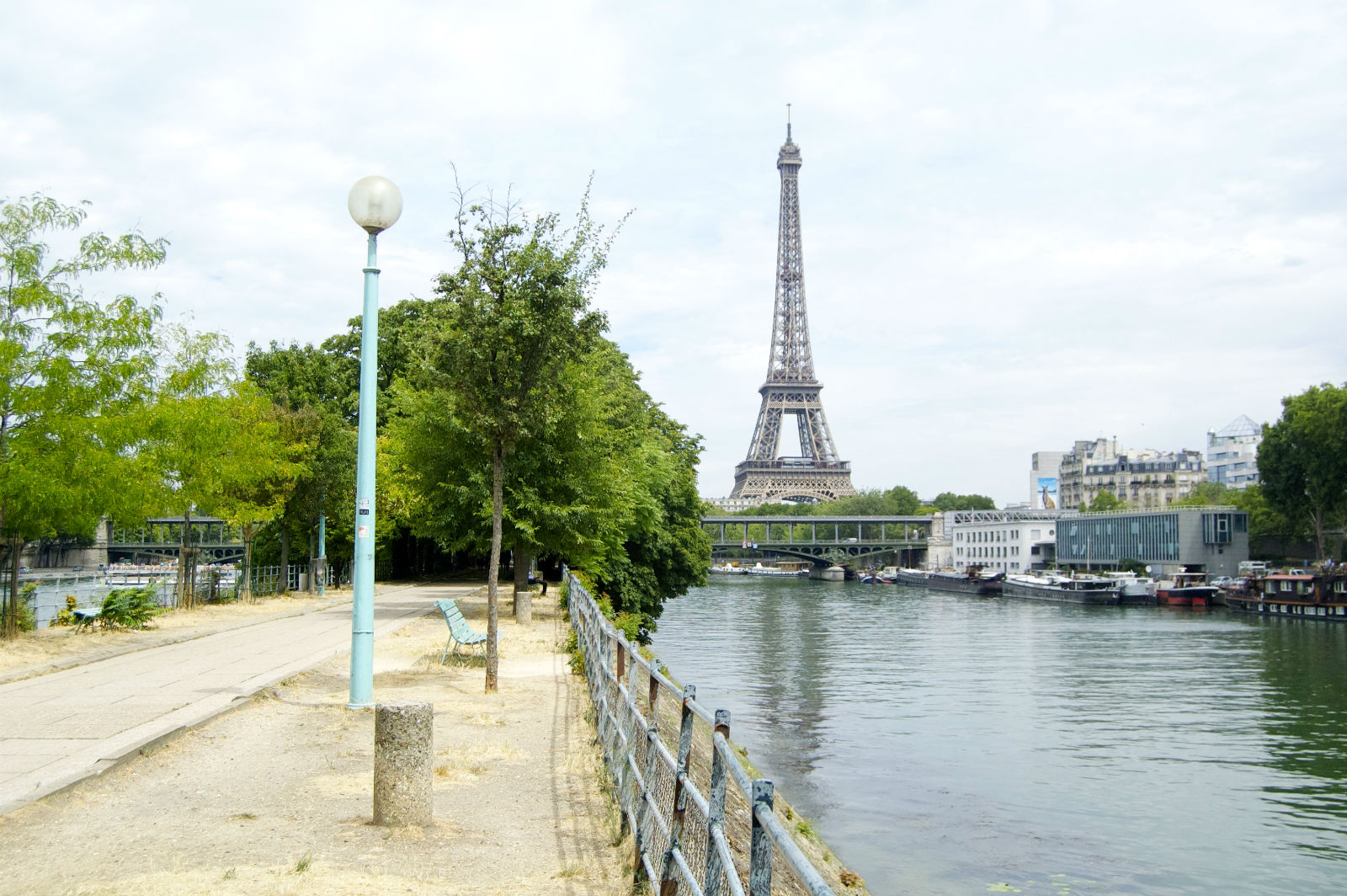 HiP Paris blog. Summer in Paris. Offbeat Romantic Itineraries in the City of Light- Ile aux Cygnes with view of Eiffel Tower