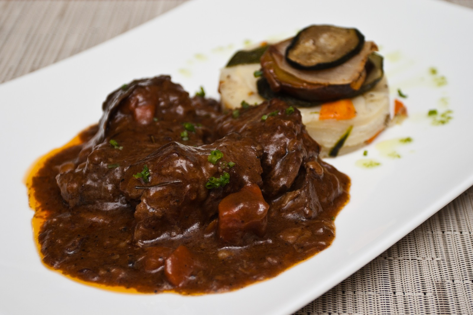 Where to go for France's best Boeuf Bourguignon, a savory and rich traditional beef stew from Burgundy.