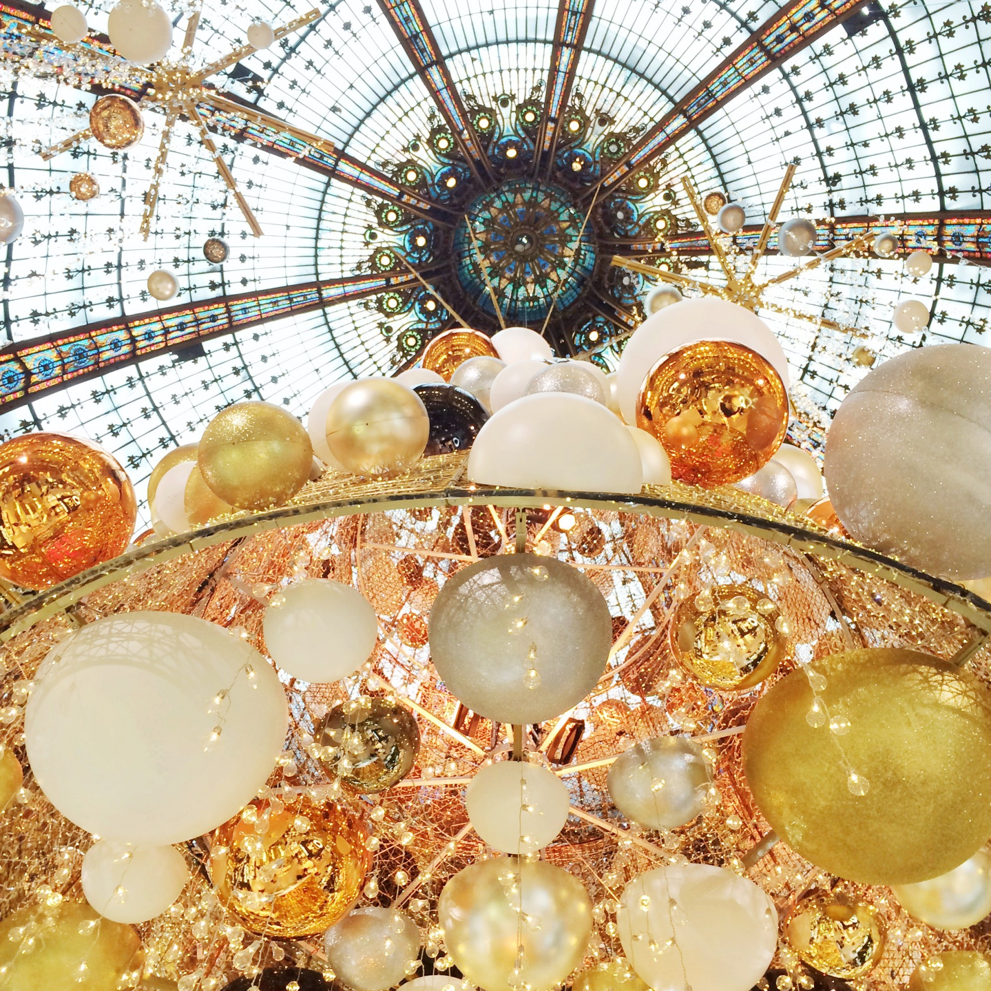 Looking up at the 2015 Christmas decor at Galeries Lafayette. Interested in an internship with HiP Paris Blog? Learn more at http://haveninparis.com/careers.php.