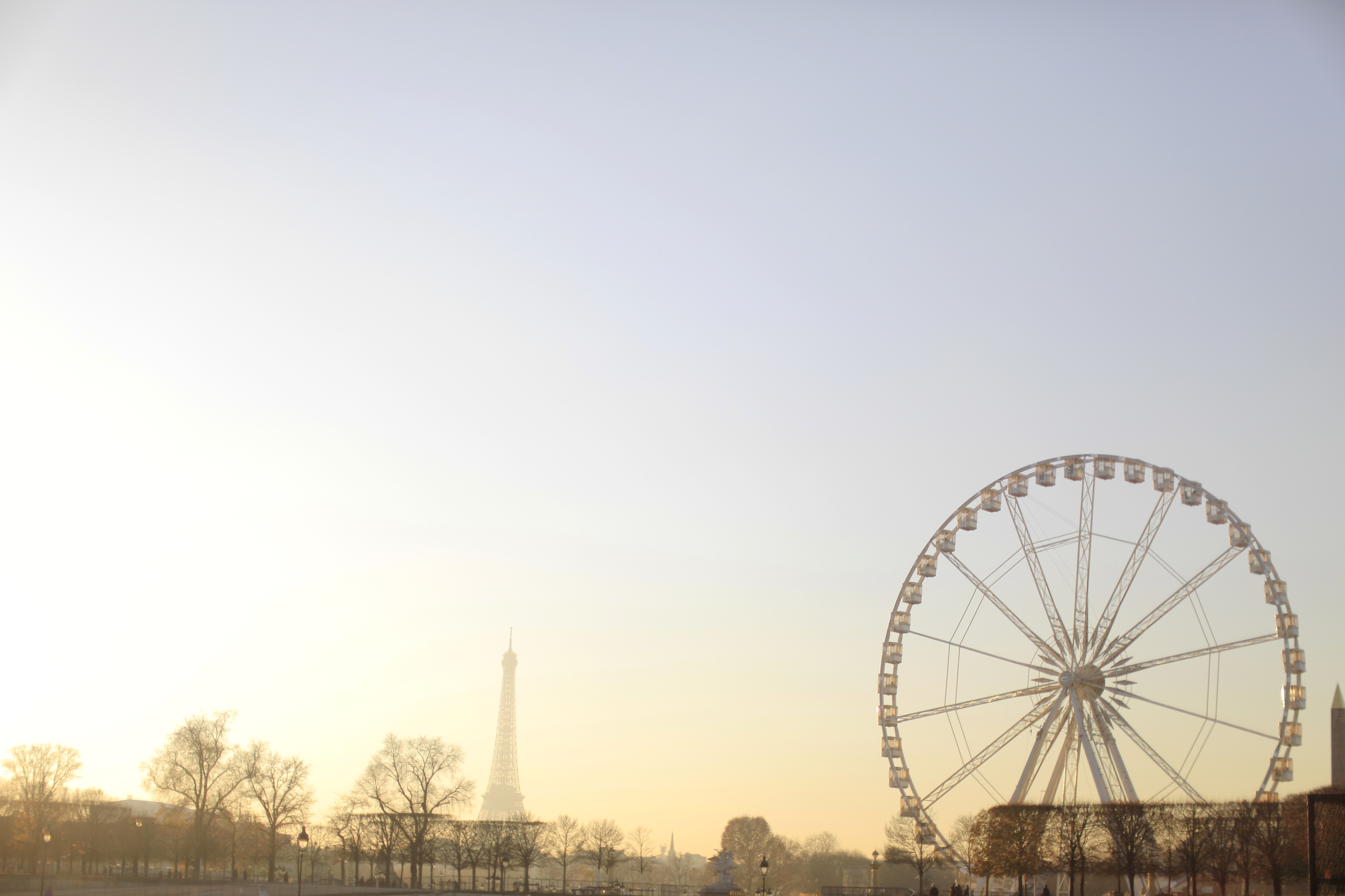 HiP Paris blog. Living, loving, learning in Paris. Mystical light over the Grand Roue and the Eiffel Tower as seen from the Tuileries. Photo by Marjorie Preval.