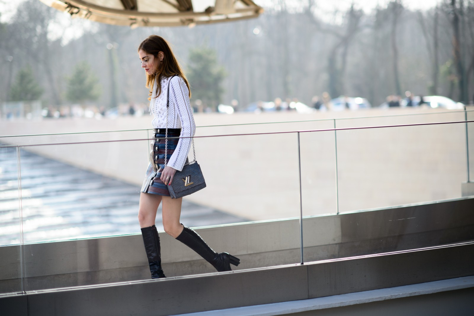 French Chic is all about decoding the Secrets of Paris Fashion, like this Parisian woman who's teamed a tartan miniskirt with knee-high boots but a high-neck, long-sleeved shirt.