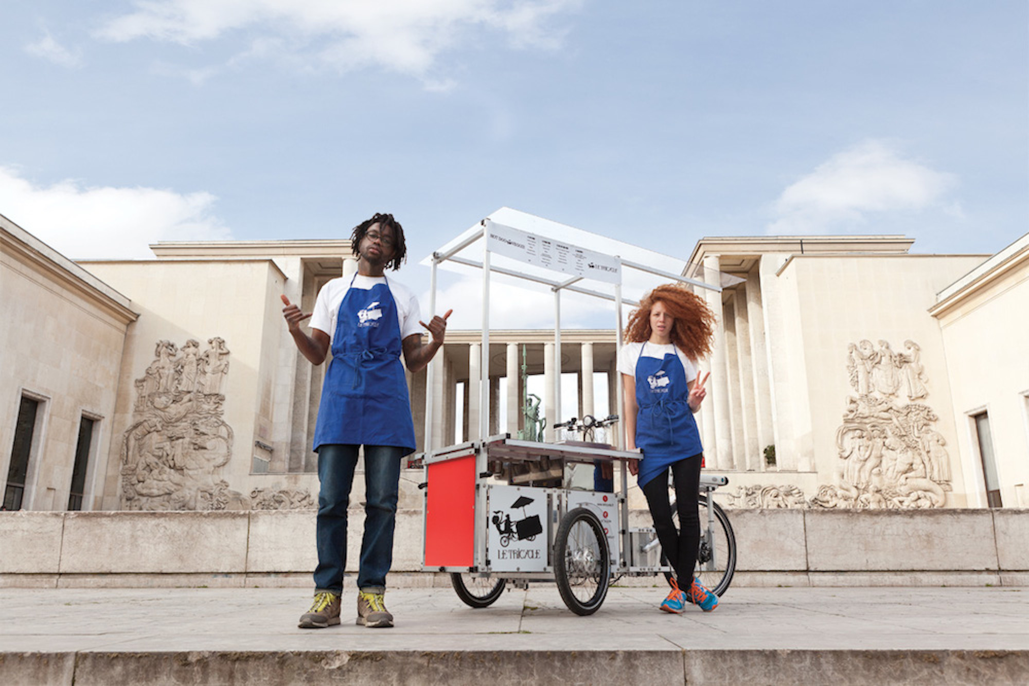 HiP Paris Blog rounds up the top brunch spots in Paris like the Tricycle, a cool vegan coffee shop run by its two founders who are posing in front of the Trocadero in blue aprons.