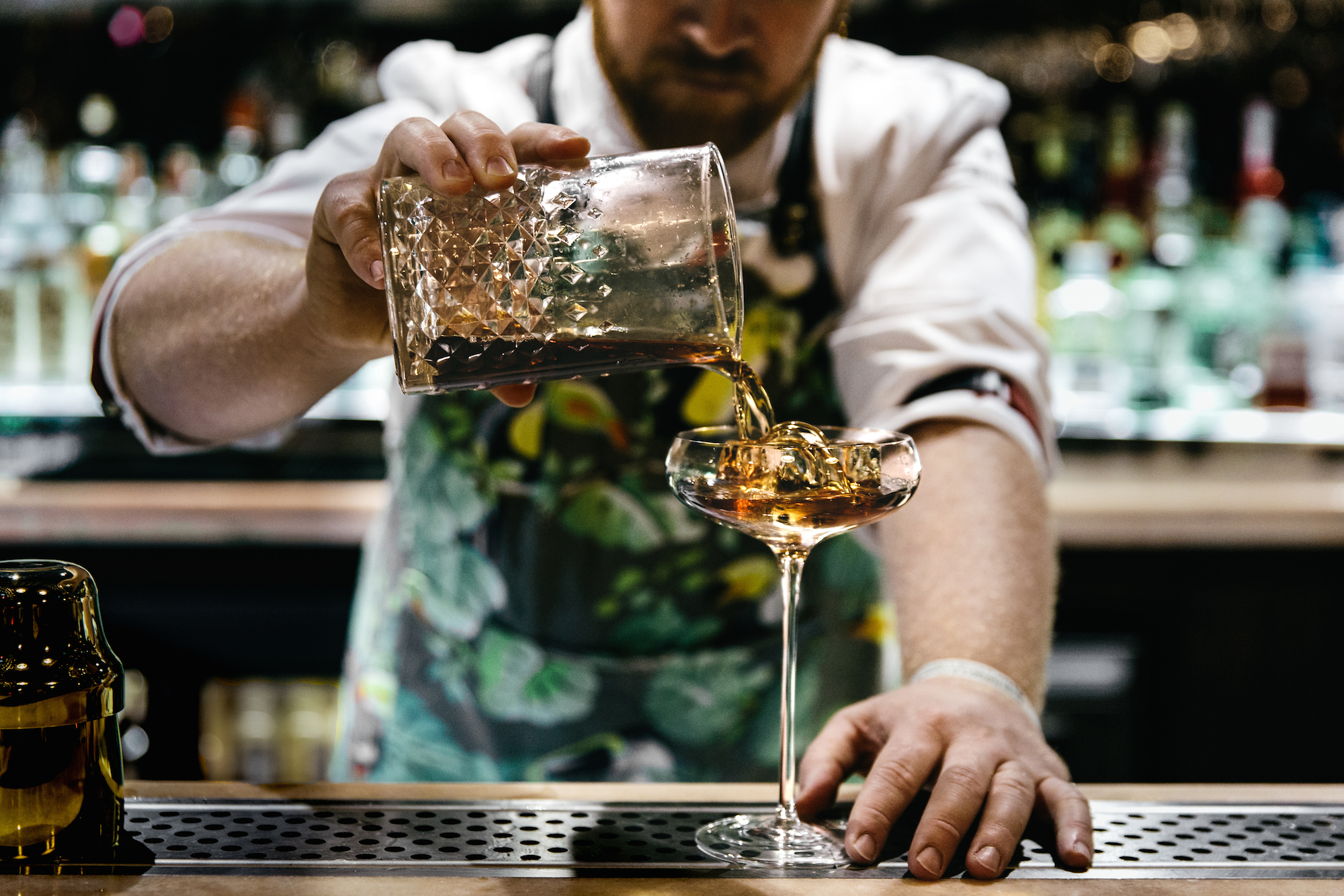 The Big Mamma Group offers Trendy, Fresh, Authentic Italian Dining in Paris as well as creative cocktails like the one being mixed by this mixologist in a Martini glass.