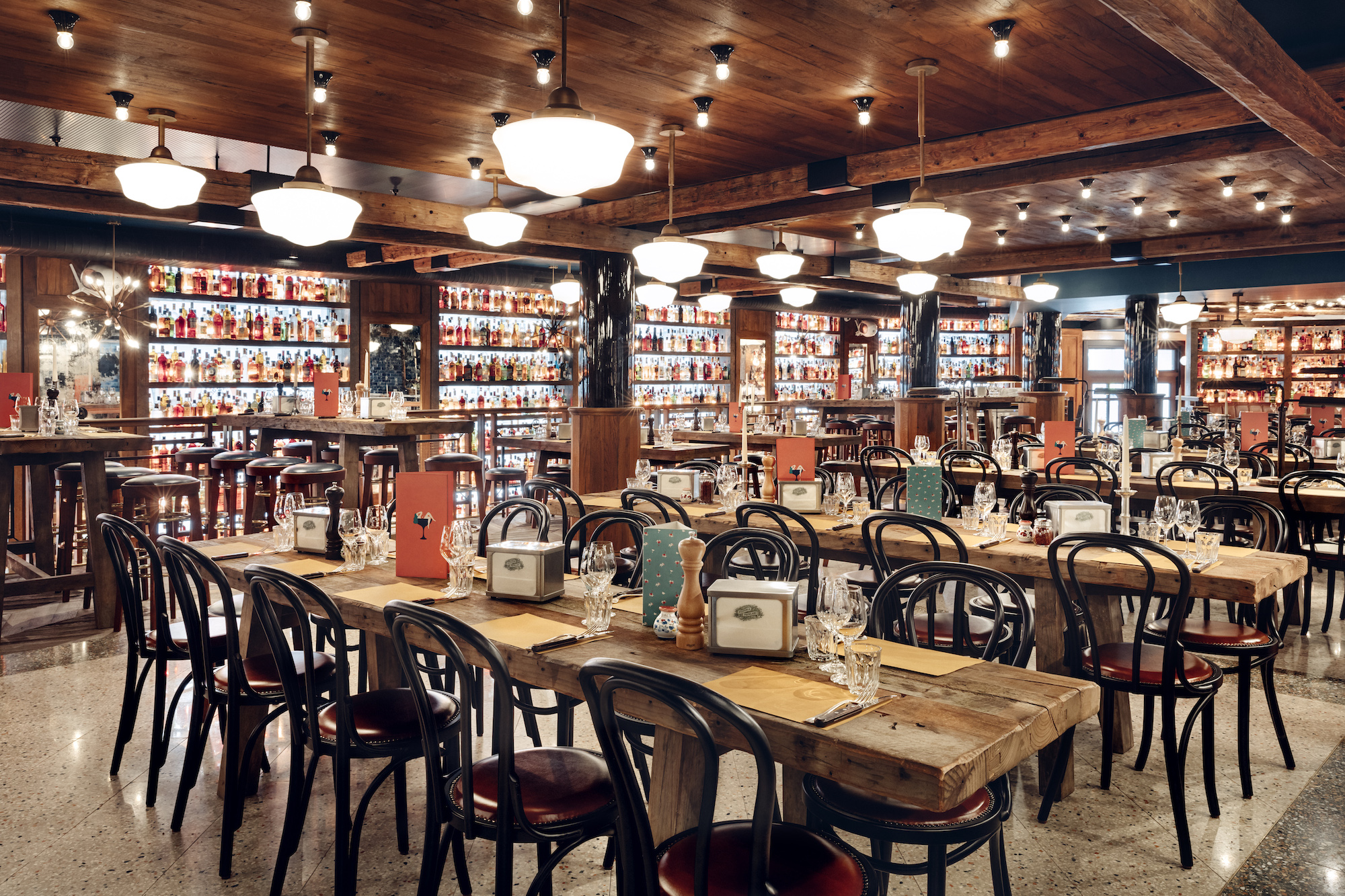 The Big Mamma Group offers Fresh, Authentic Italian Dining in Paris, in trendy surroundings like this space with back-lit walls lined by spirits for cocktails.