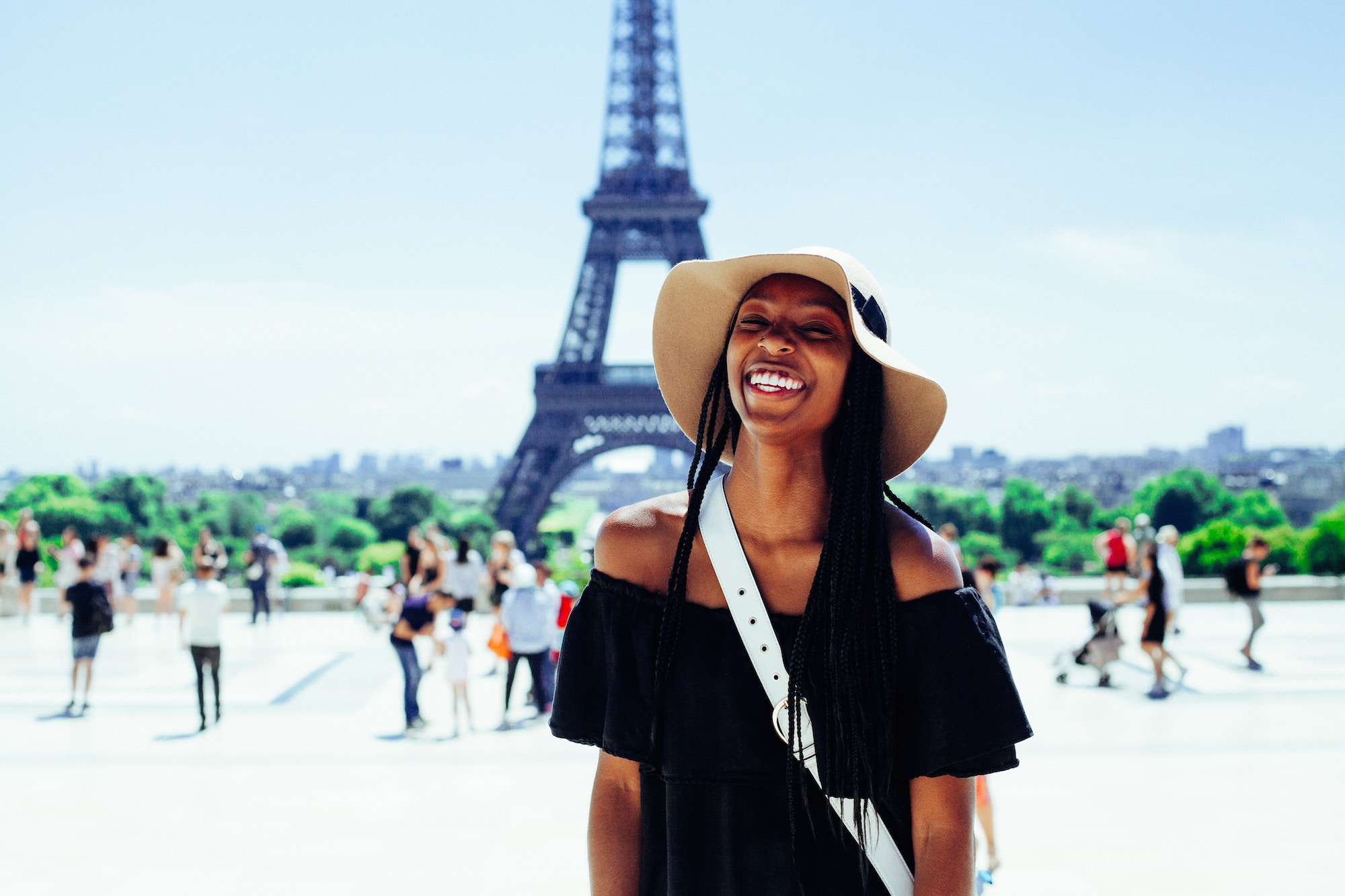 HiP Paris Blog rounds up the top French podcasts, which gives you some sense of the cultural landscape in the country, and can even be quite funny and make you laugh, like this black girl smiling happily in summer in Paris as she poses in front of the Eiffel Tower at Trocadero.