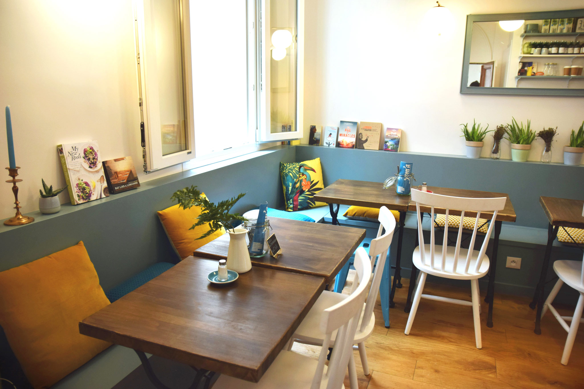HiP Paris' guide to gluten-free restaurants and bakeries in Paris, includes Yem'a with its cheery decor of wooden tables, potted cacti and mustard-yellow and vibrant turquoise cushions.
