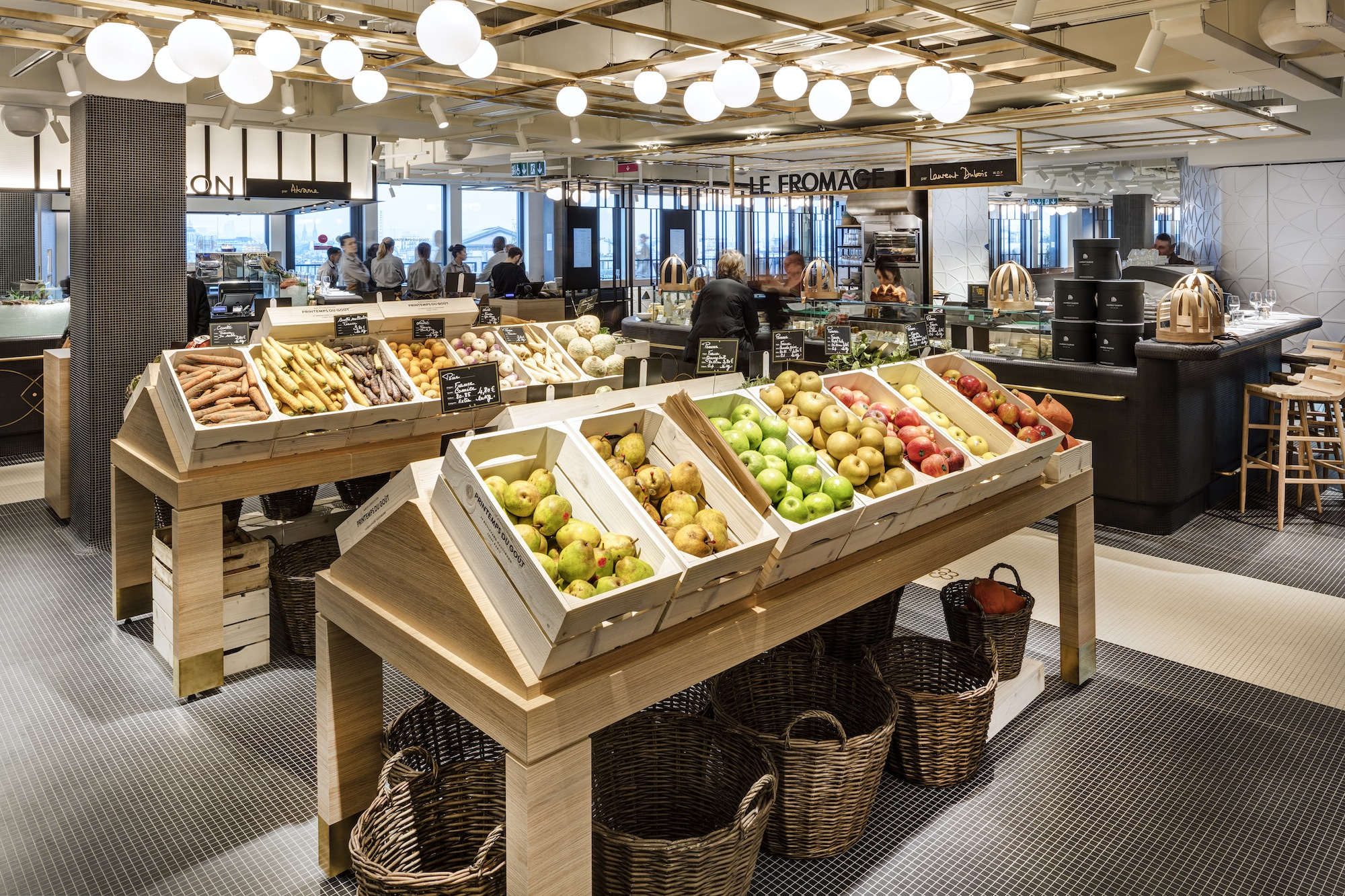 The fruit and vegetables in wooden crates at Printemps du Gout at department store Printemps in Paris.