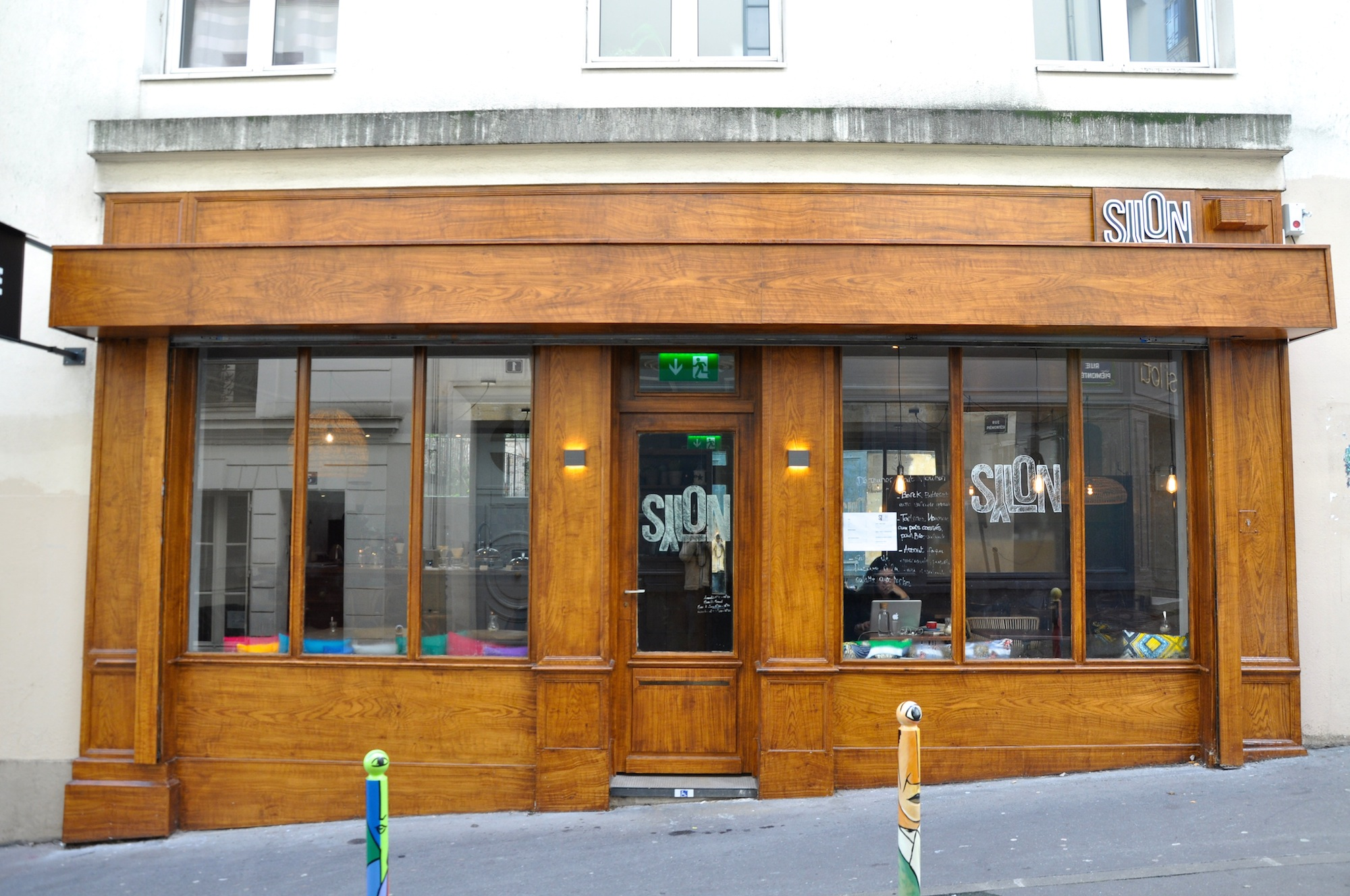 The best new places to eat in Paris' Montmartre, like SyLon with its wooden shop front.