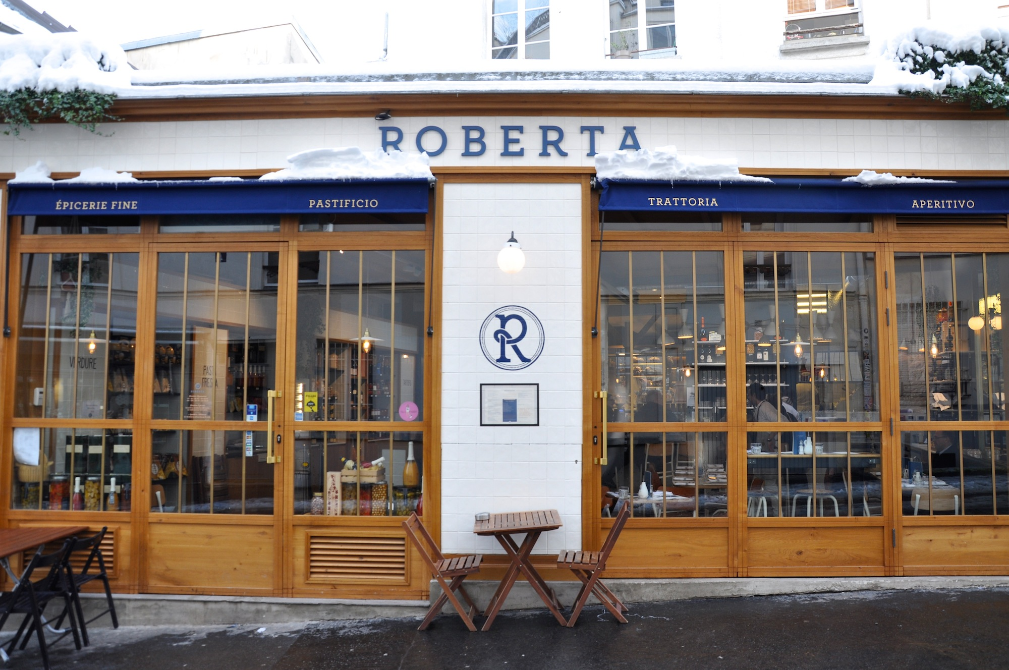 One of the best places to eat in Montmartre, is Roberta, an Italian restaurant with a wooden facade and a window looking out onto a cobblestone street.