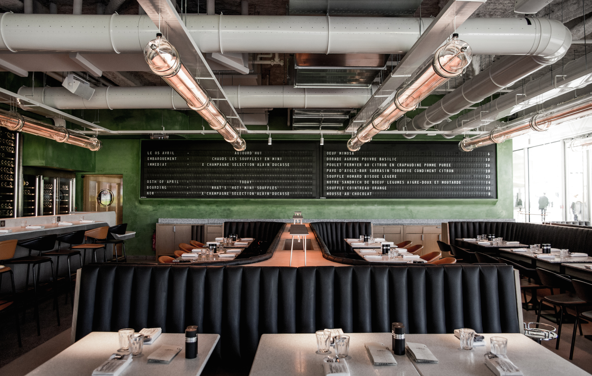 Champeaux restaurant is the place to go to eat souffle in Paris and it comes with sleek updated diner-style interiors with a green wall and fluted leather banquettes.