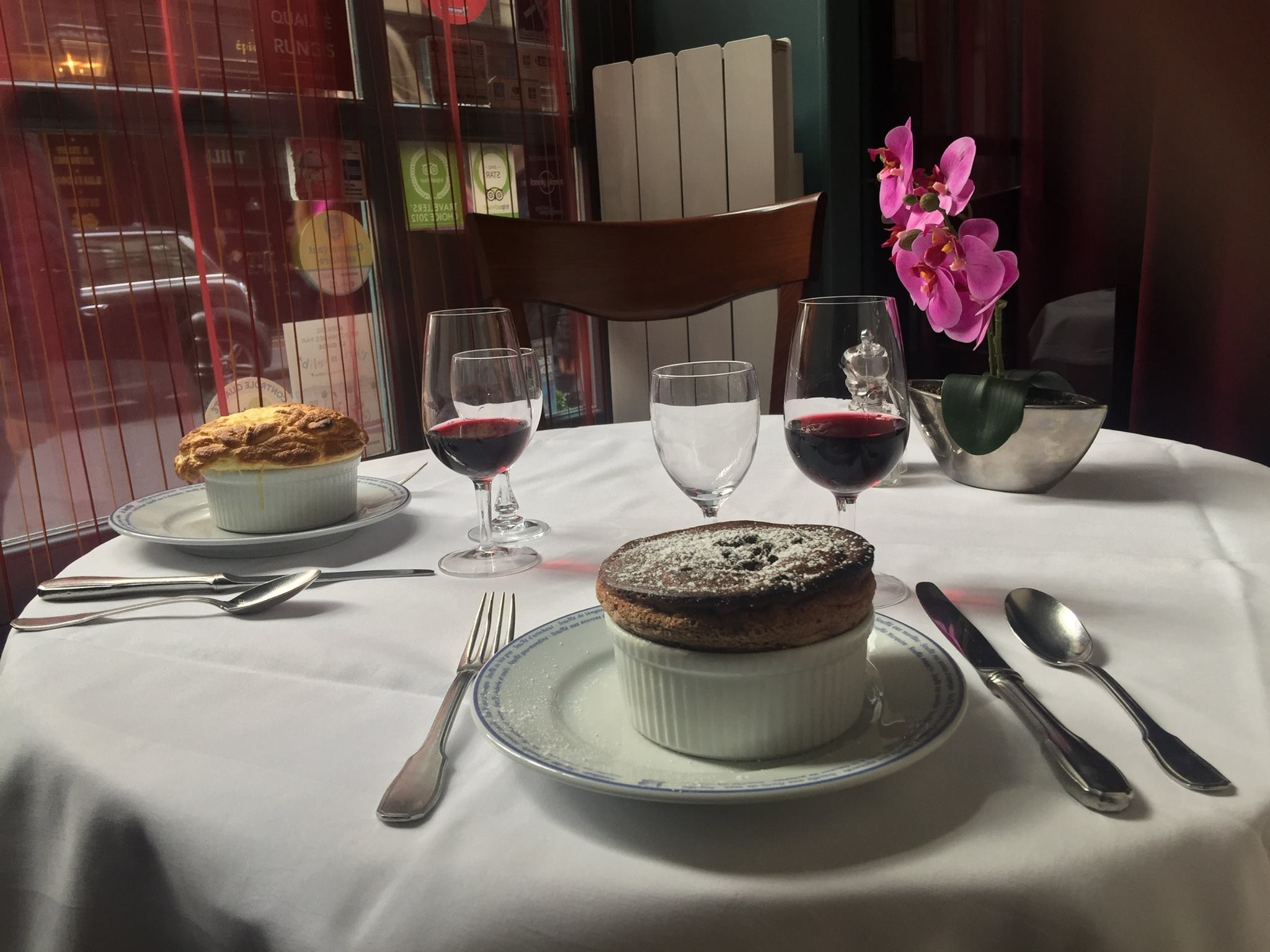 A table at Le Souffle restaurant with cheese and chocolate souffles, one of the best places to eat souffle in Paris.