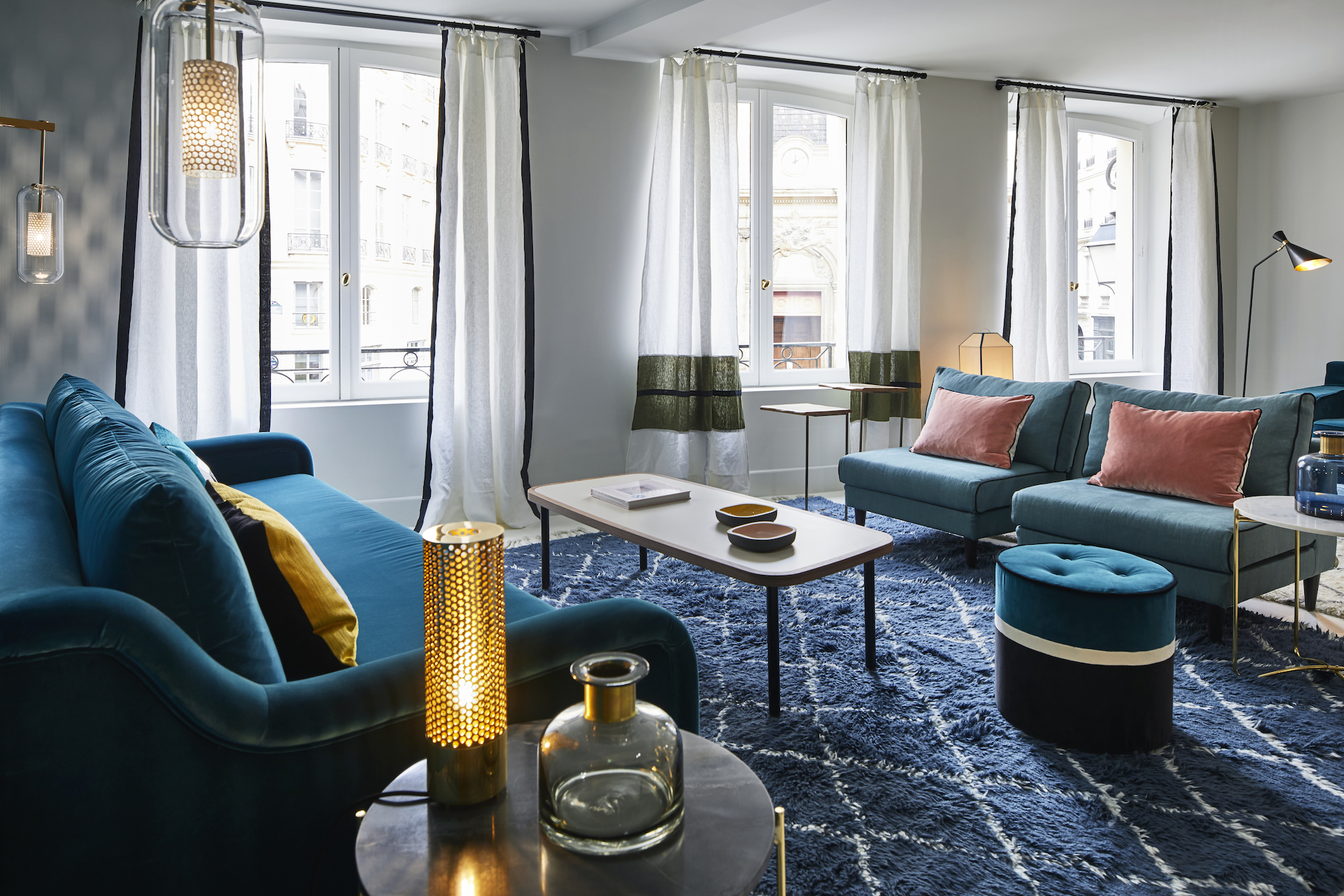 A showroom of cozy blue couches at Maison Sarah Lavoine home interior store in Paris.