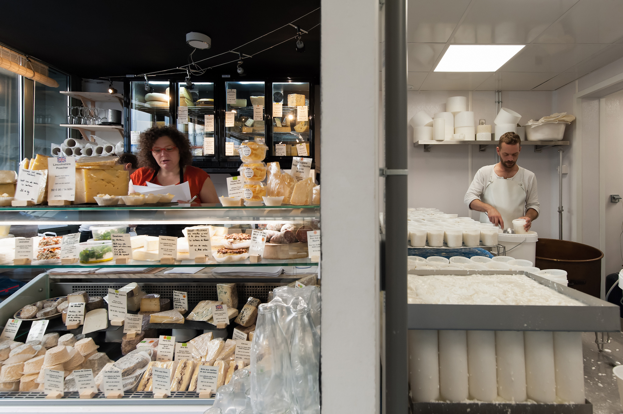HiP Paris Blog discovers Paris' first cheese dairy La Laiterie de Paris with its wonderful selection of cheeses behind the glass counter (left). Pierre Coulon, the cheese maker in his workshop (right).
