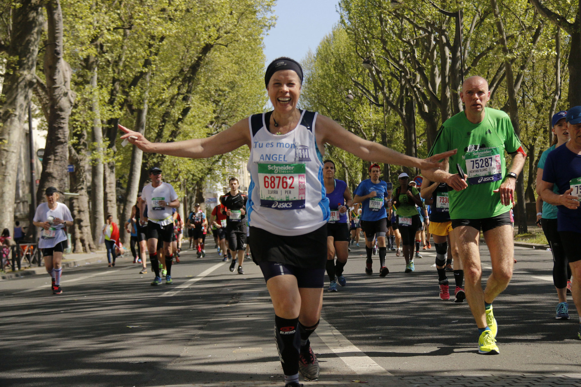 A happy female runner at Paris' annual marathon in April.