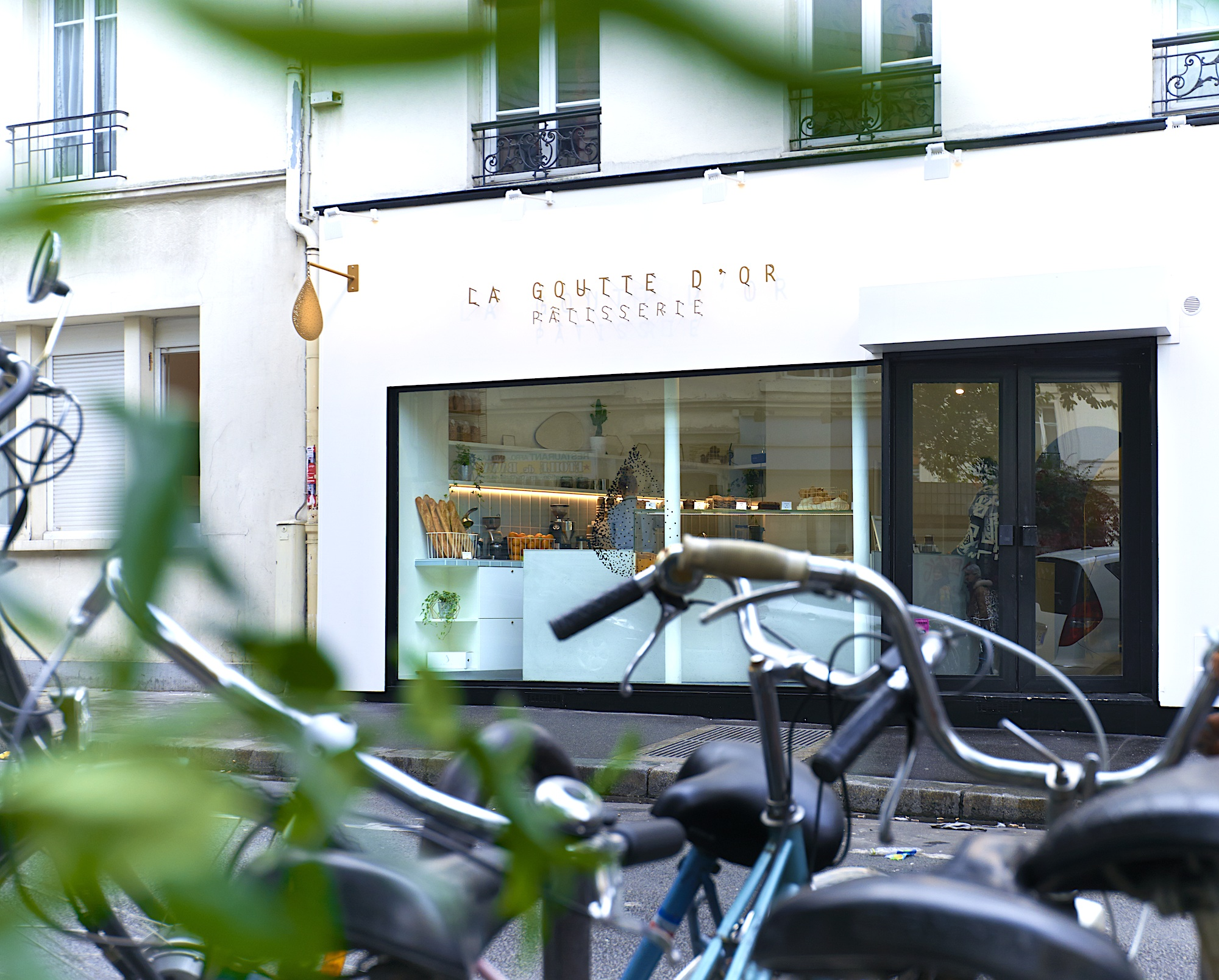 One of the best cake shops in Paris is La Goutte d'Or patisserie in the 18th arrondissement, with its large window running across the entire space.