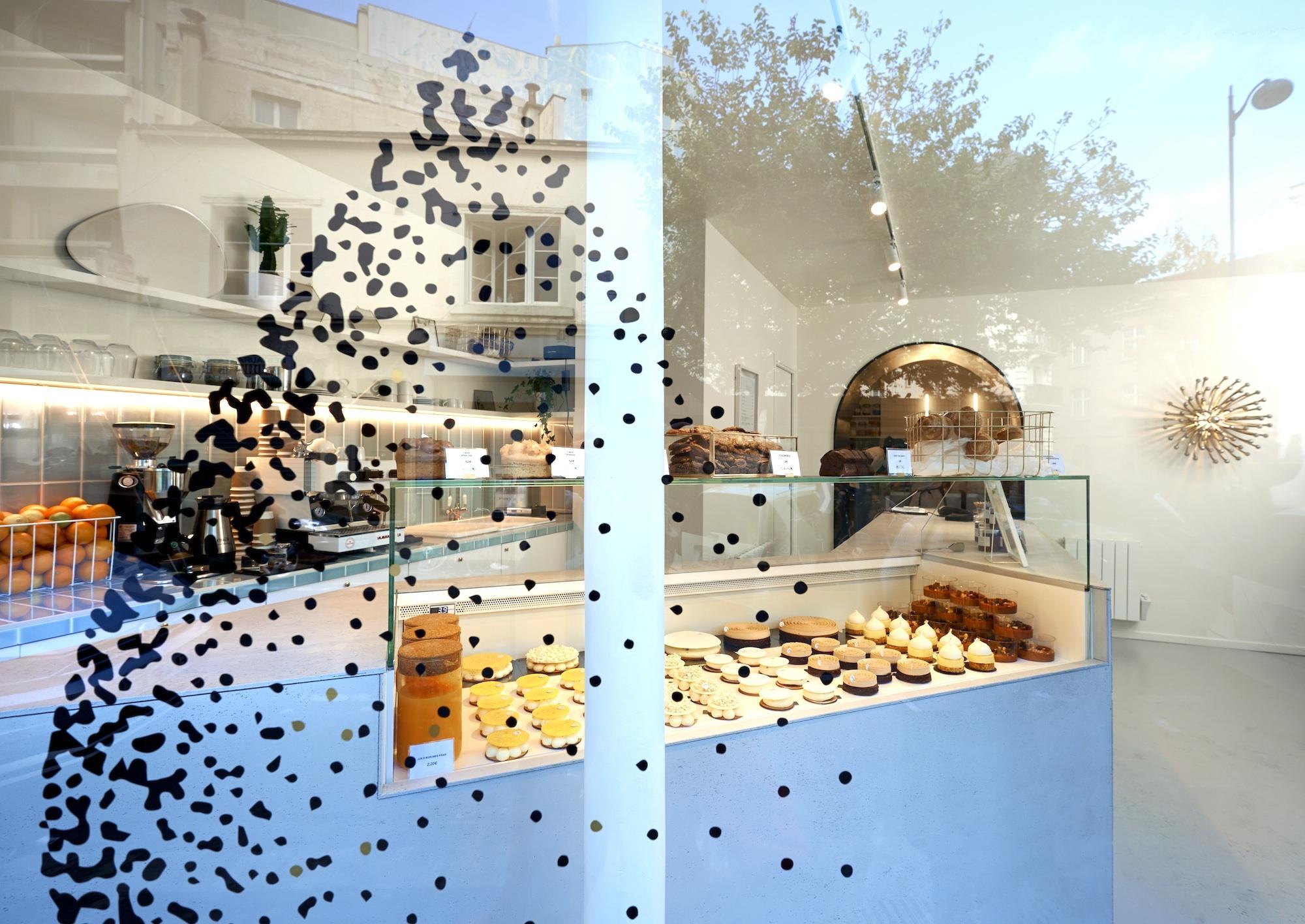 Yann Menguy's pastries in Paris cake shop La Goutte d'Or, seen through the window.
