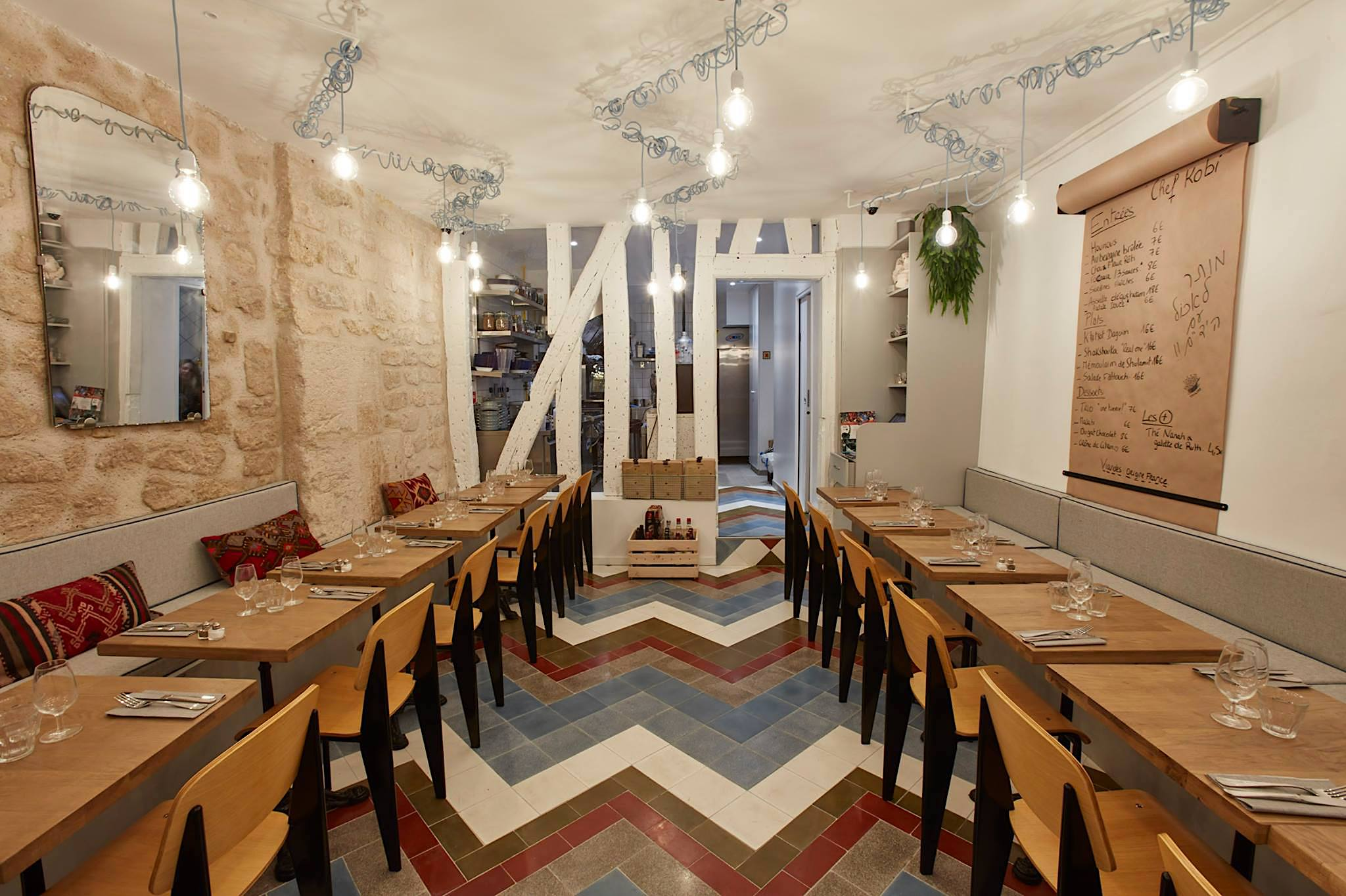 One of the best places to have Tel Aviv food in Paris is Tavline, with its slick contemporary decor of exposed brick walls and blue and red zig zag-tiled floors.